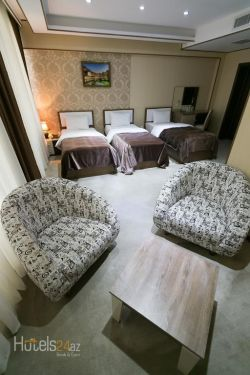Sharq Plaza Hotel - Quadruple Room