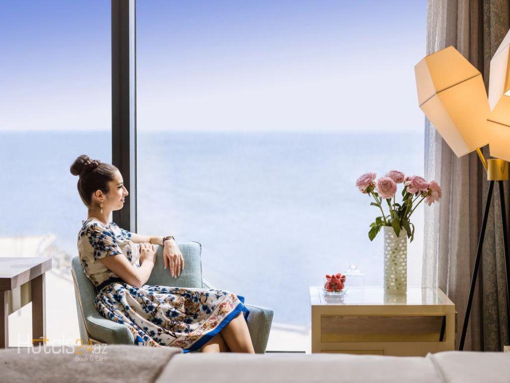 Улучшенный двухместный номер с 2 отдельными кроватями и видом на море
